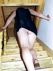 11 pictures - Wearing no panties and walking up the stairs this lady was destined to get her ass and pussy caught on cam