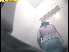 14 pictures - Naughty mama tinkling straight onto voyeur camera