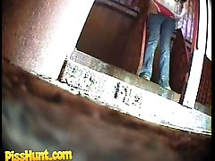 14 pictures - Pissing girl get busted and filmed in public loo
