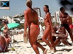 10 movies - Sexy babes in tiny bikinis get spied on hidden camera when walking out of the warm sea